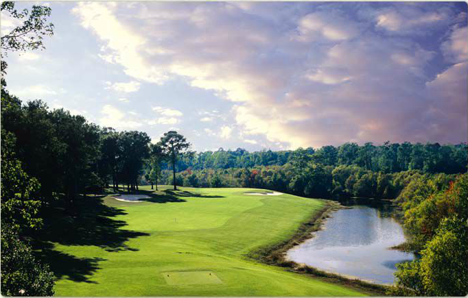 Image of one of the golf holes at sunset.